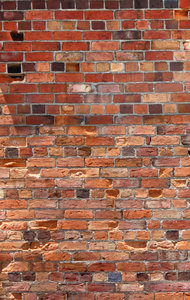 Brick texture: Successive layers of brick show variations from older to newer