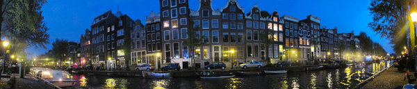 Amsterdam panorama: View of Amsterdam canal with traditional houses at night