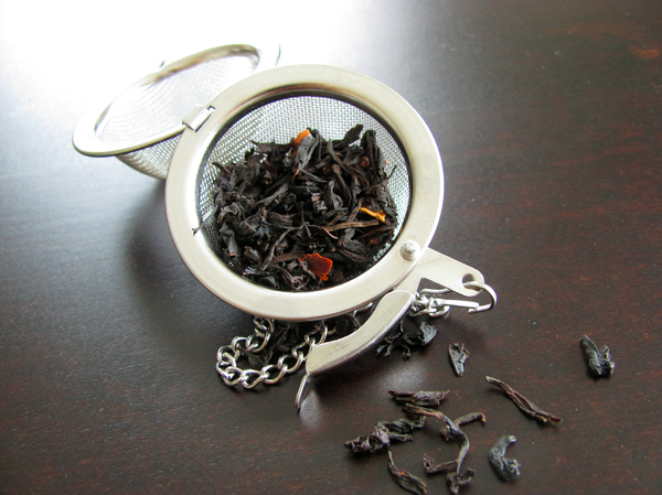tea strainer: black tea leaves in tea strainer