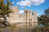 Castle and moat: Part of Bodiam Castle and moat in East Sussex, England. Photography of the exterior of this National Trust property was freely permitted.