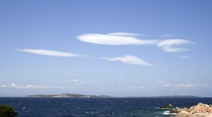 Strange clouds: Strangely shaped clouds above the Maddalena Islands, Sardinia.