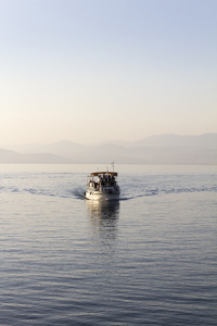Tour boat: A tour boat on the Sea of Galilee (also called Kinneret, Lake of Gennesaret, Lake Tiberias), Israel.