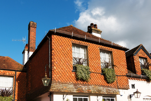 Wall tiles: Traditional terracotta wall tiles on an old house in a village in Surrey, England.