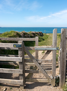 Gate to the sea: A footpath gate to the coast of Cornwall, England.