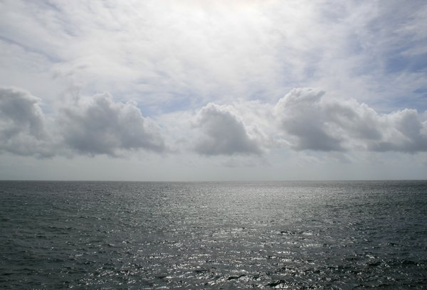 Cloud and ocean: The Atlantic Ocean on a calm day in Madeira.