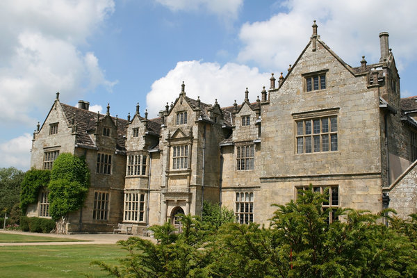 Manor house: An ornamental stone manor house in West Sussex, England.