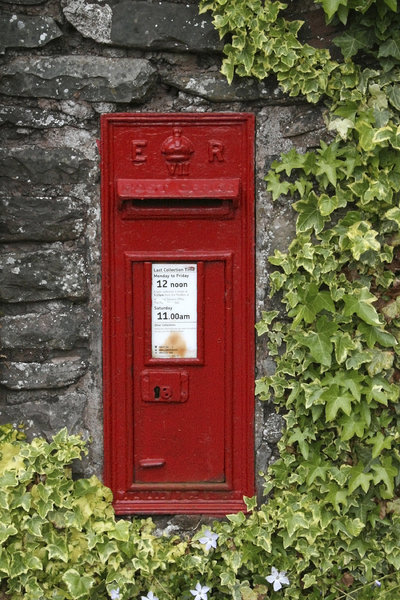 Old postbox: An old postbox mounted on a stone wall in Devon, England.
