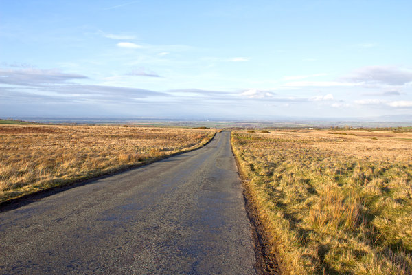 Moorland road: A moorland road in northern England in evening light.