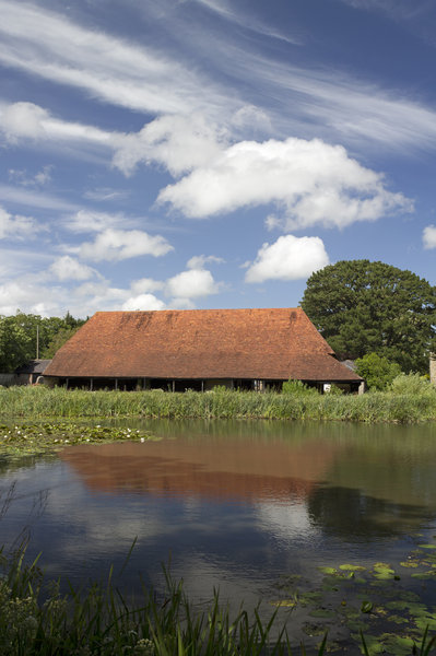 Barn by a moat: A large barn by the moat at Michelham Priory, Sussex, England. Photography in this estate was freely permitted.