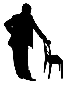 Man leaning on chair: Man leaning on the chair.