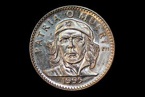 Cuban coin 2: Patria o Muerte: Patria o Muerte means Nation or Dead. Properly message about communism