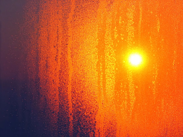 Condensed Sun: Early morning Sun caught through condensate on window