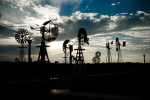 Windmills at Sunset 1: Windmills of all sorts and sizes at sunset