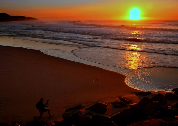 Sunrise Photographer 2: Series of images of photographer taking pictures of the Indian Ocean Sunrise, in Zululand, South Africa