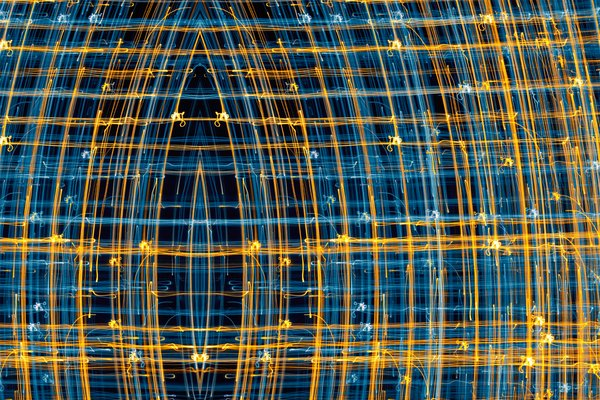 Streaks of Light: Abstract background generated from camera panning on Christmas lights. Some repositioning to simulate an ominous eye.