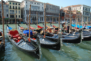 Gondola Parking: Line-up of Gondalas, Venice, Italy.