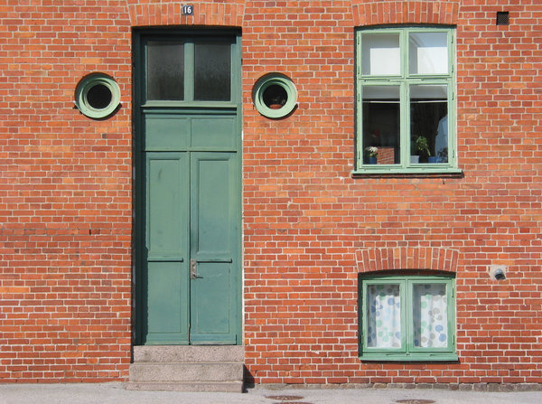 door and windows: Unusually tall door with various windows captured in Lund, Sweden.