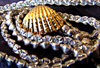 sparkles & gold: string of diamantes surrounding gold shell