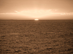 sepia sunset: sepia sunset over ocean