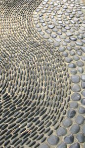 reflexology paths: raised stones in park garden paths