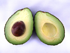 avocados - ripe: dark ripe avocados - cross section and seed