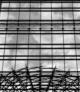 wired-up windows: grey cloudy skies seen through modern glass and steel