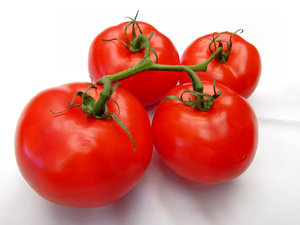 vine ripened tomatoes4: large firm standard round tomatoes in vine clusters