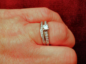 married1: showing engagement and matching wedding rings