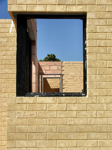 construction underway6: early stage of suburban housing construction --  views through window frames