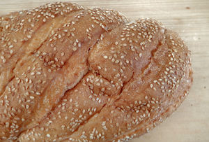 on the bread board6: white sesame bread loaves variety