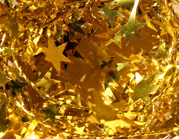 Christmas colours: golden star-shaped Christmas tinsel