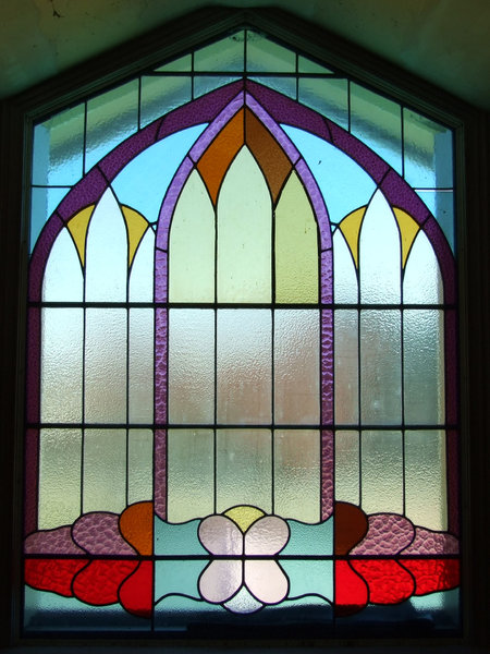 underneath the arches: arched stained glass windows