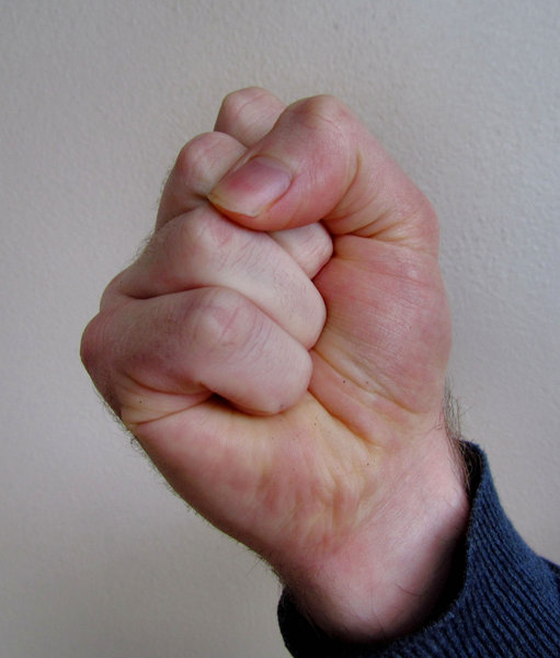 clenched fist1: man's tightly clenched fist