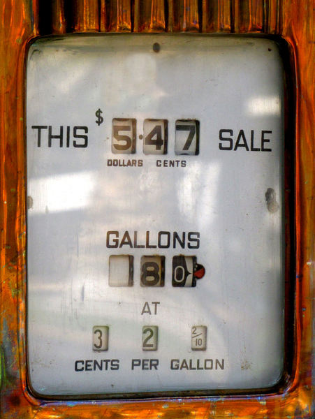 frozen value: old disused petrol bowser showing histirc price for petrol