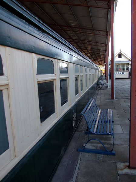 at the station1: historic station platform with waiting railway carriages