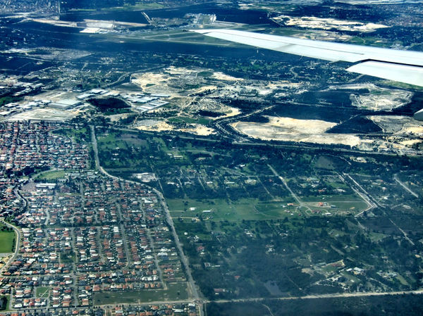 suburban development1: blue hazed aerial view of outer suburbs and new town developments
