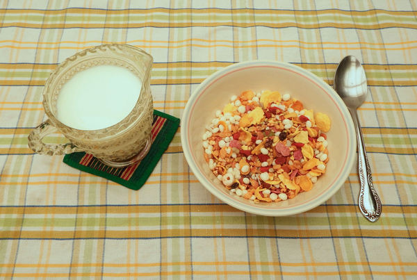 cereal breakfast3: bowl of Western breakfast cereals with jug of milk - muesli mixture