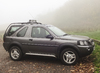 Land Rover Freelander: My Landy shot against a background of trees and atmospheric mist.
