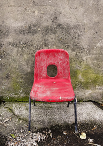 Red Chair: A grungy red chair against a grungy wall.