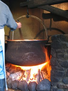 The magic brew-: Actually the traditional way of heating milk in the process of cheesmaking somewhere in the swiss alps.