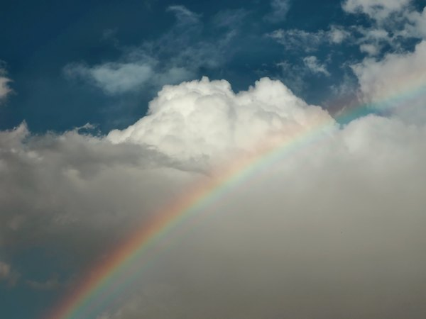 Nature's bling-bling: Rainbow on stormy cloud-