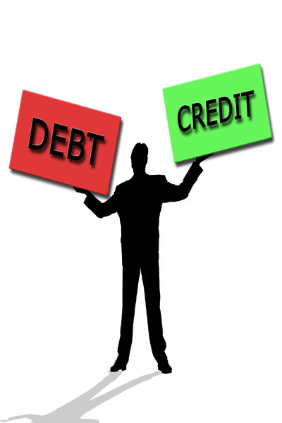 Debt & Credit: Debt and credit concept male juggling two boxes