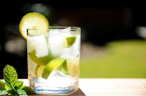 Lime Drink: Cool lime drink in a clear glass with mint in an outside setting