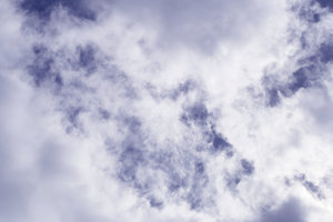 Cloudy Sky: Lots of whispy white clouds in a blue sky. Makes a great background or texture.