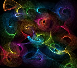 Rainbow Swirls 1: Lots of rainbow coloured swirls make a colourful background, texture or fill.