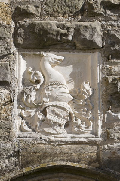Stone crest: A stone heraldic crest at Nymans, West Sussex, England. Photography in the grounds of this National Trust property is freely permitted.