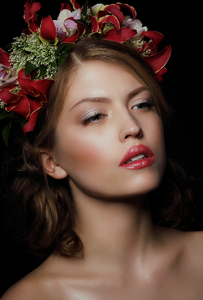 Beautiful Girl with Flowers Wr: Beautiful Girl with Flowers Wreath.  Fashion Makeup. Portrait of Pretty Young Woman with  Flowers.