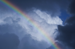 Rainbow in the sky: Cloudy sky with rainbow