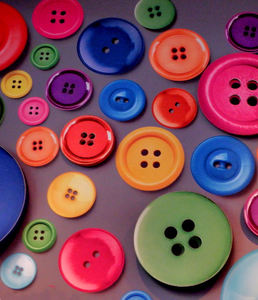 button background1: a variety of different sized, shaped and coloured buttons covering interior wall background