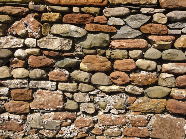 Old Stone Wall: An old barn wall made from stones.